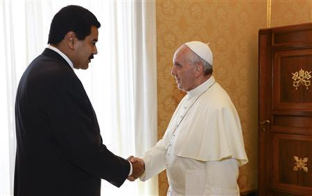Pope Francis shakes hands with Venezuela's President Nicolas Maduro during a meeting at the Vatican